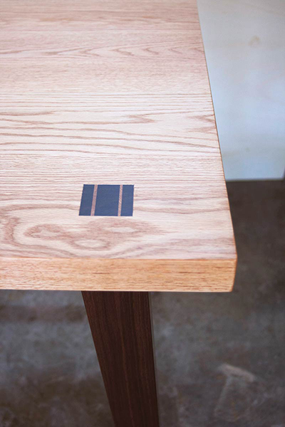 detail of Taylor Desk, shown in red oak and walnut