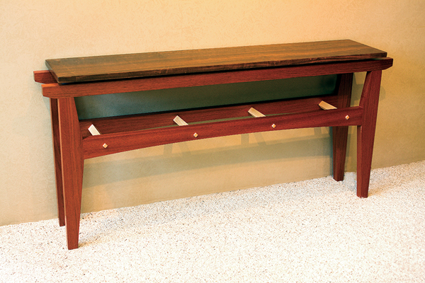 Sofa table, Brazilian cherry, Imbuya, and maple, 56 x 10.75 x 26 inches, $1,460